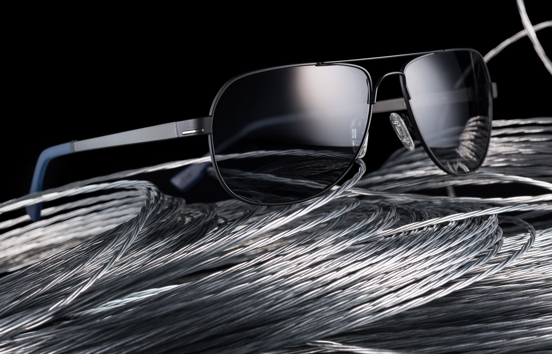 mens sunglasses conceptual photography still life with cable