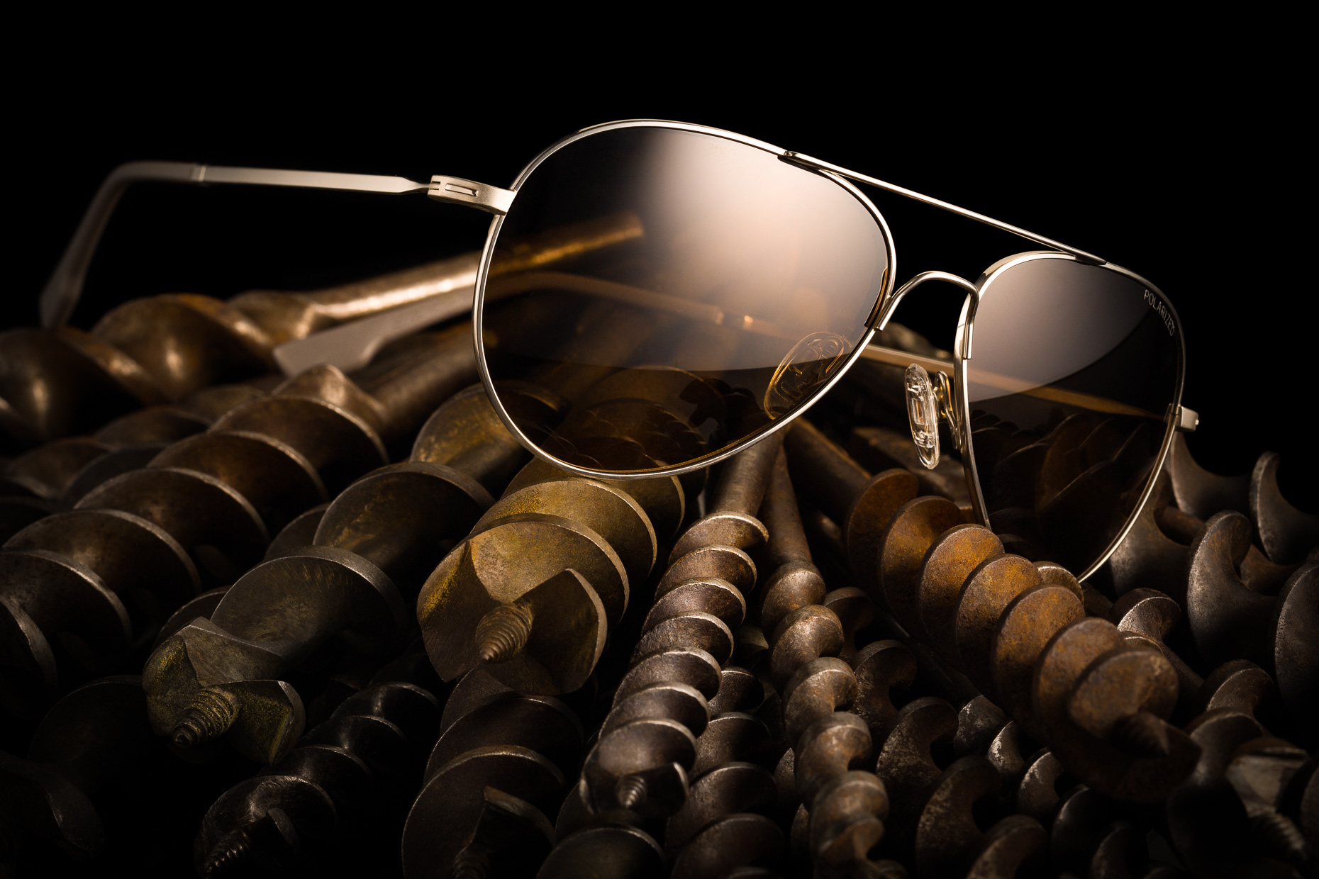 moody sunglasses lifestyle mens sunglasses conceptual photography still life with drill bit