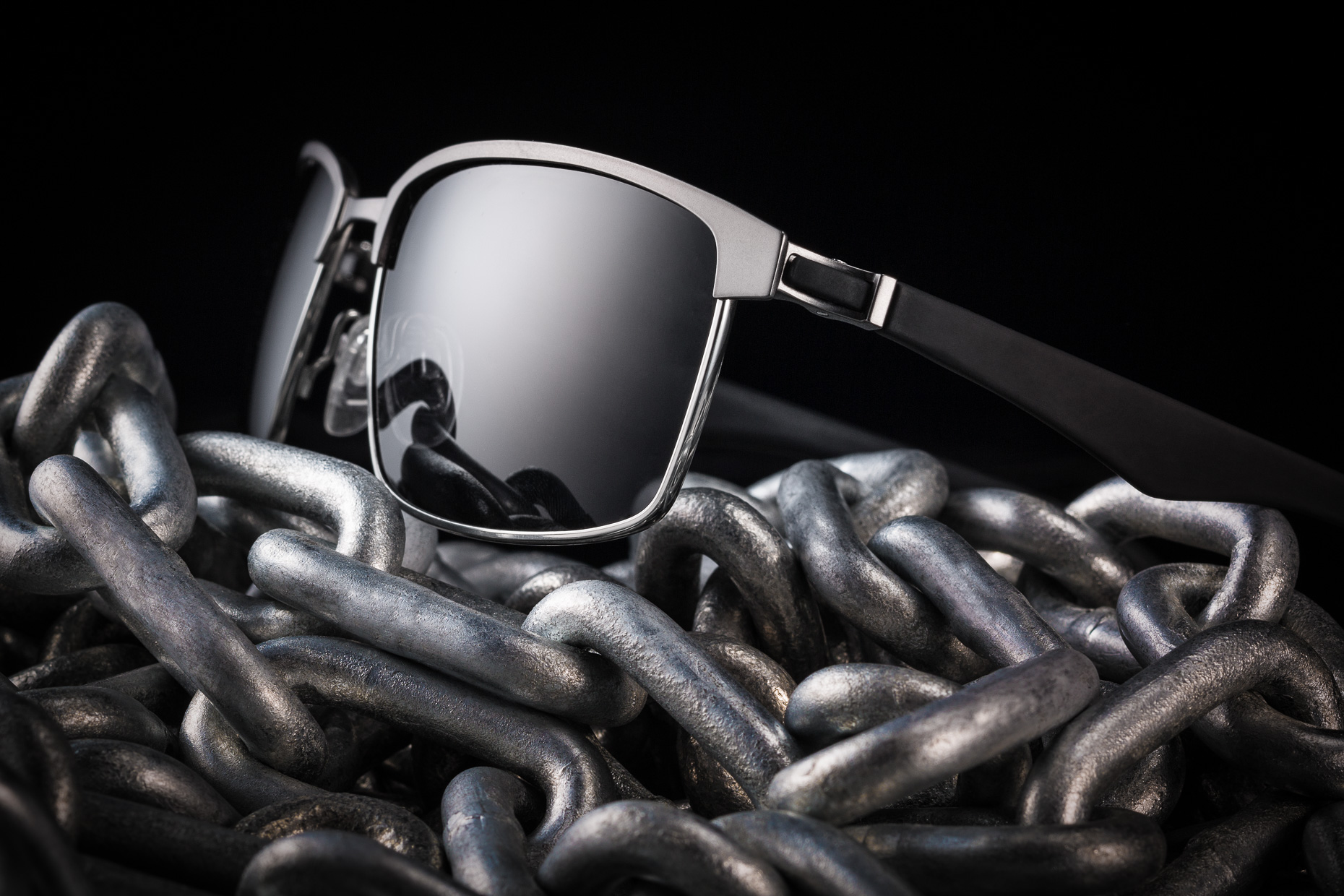 sunglasses on chainmens sunglasses conceptual photography still life