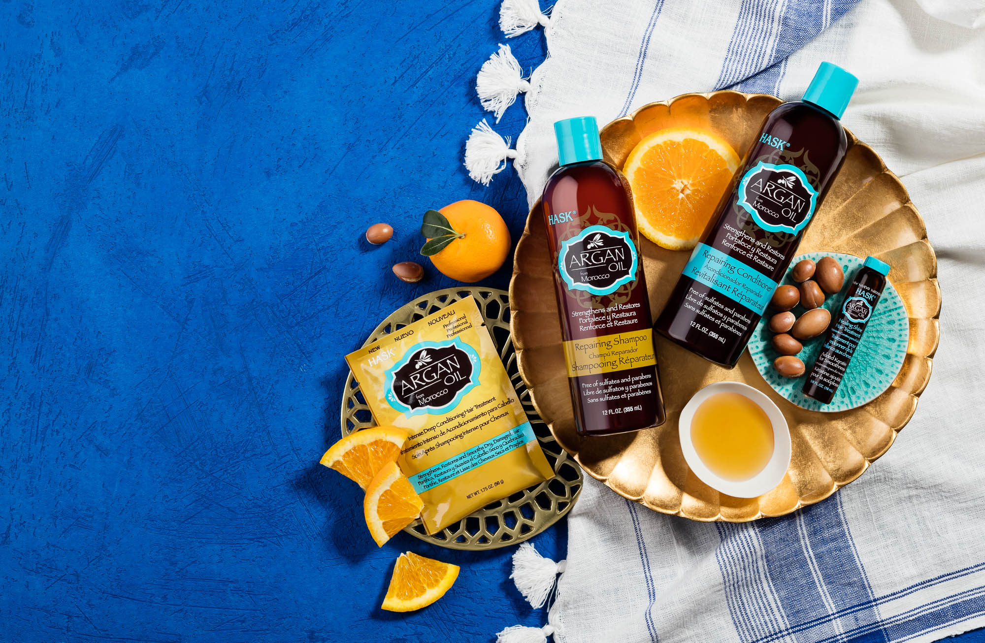 lifestyle still life photography with argan oil shampoo and conditioner