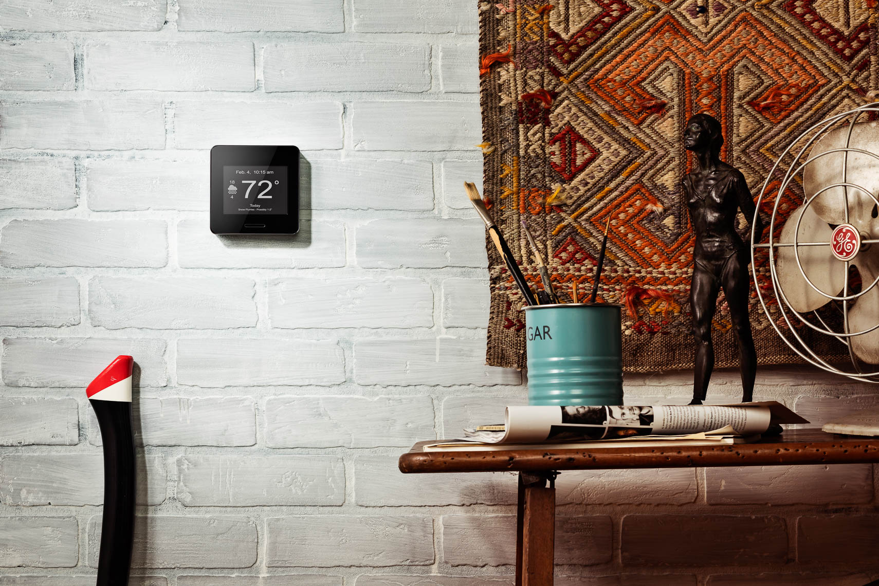 lifestyle photography of wifi weather station on white brick wall