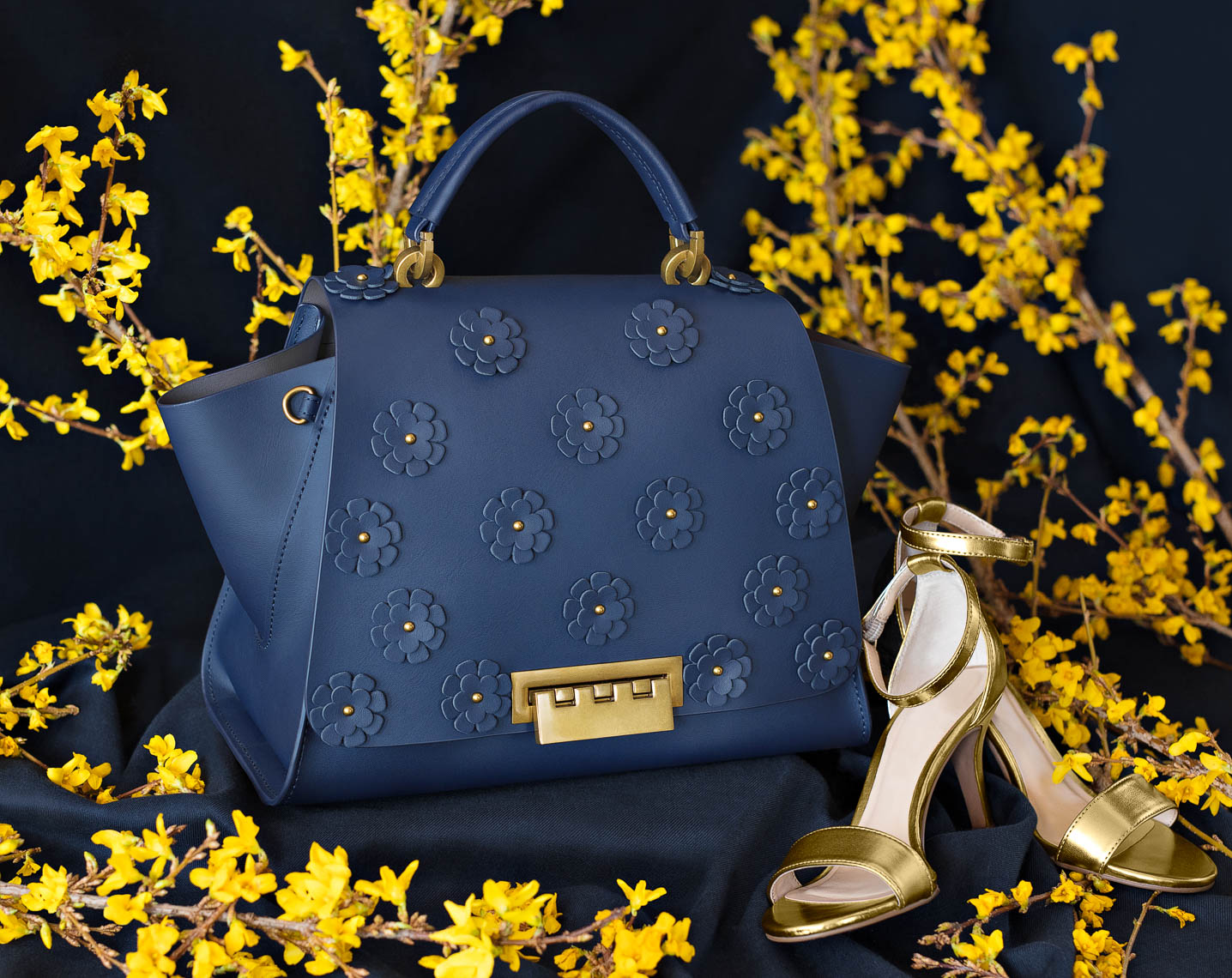 Dark blue leather tote and gold sandals