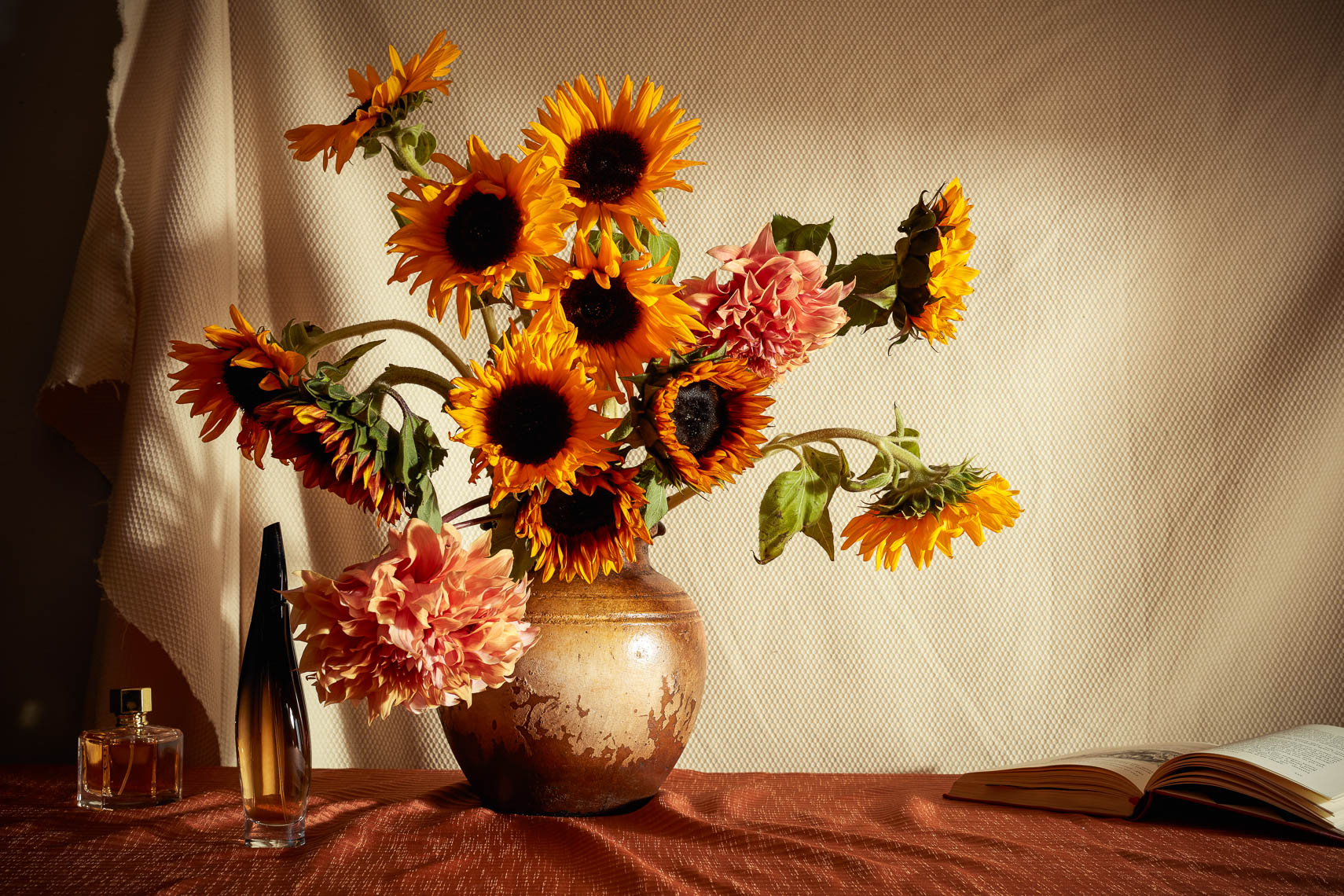 sunflowers and perfume still life photography with vase