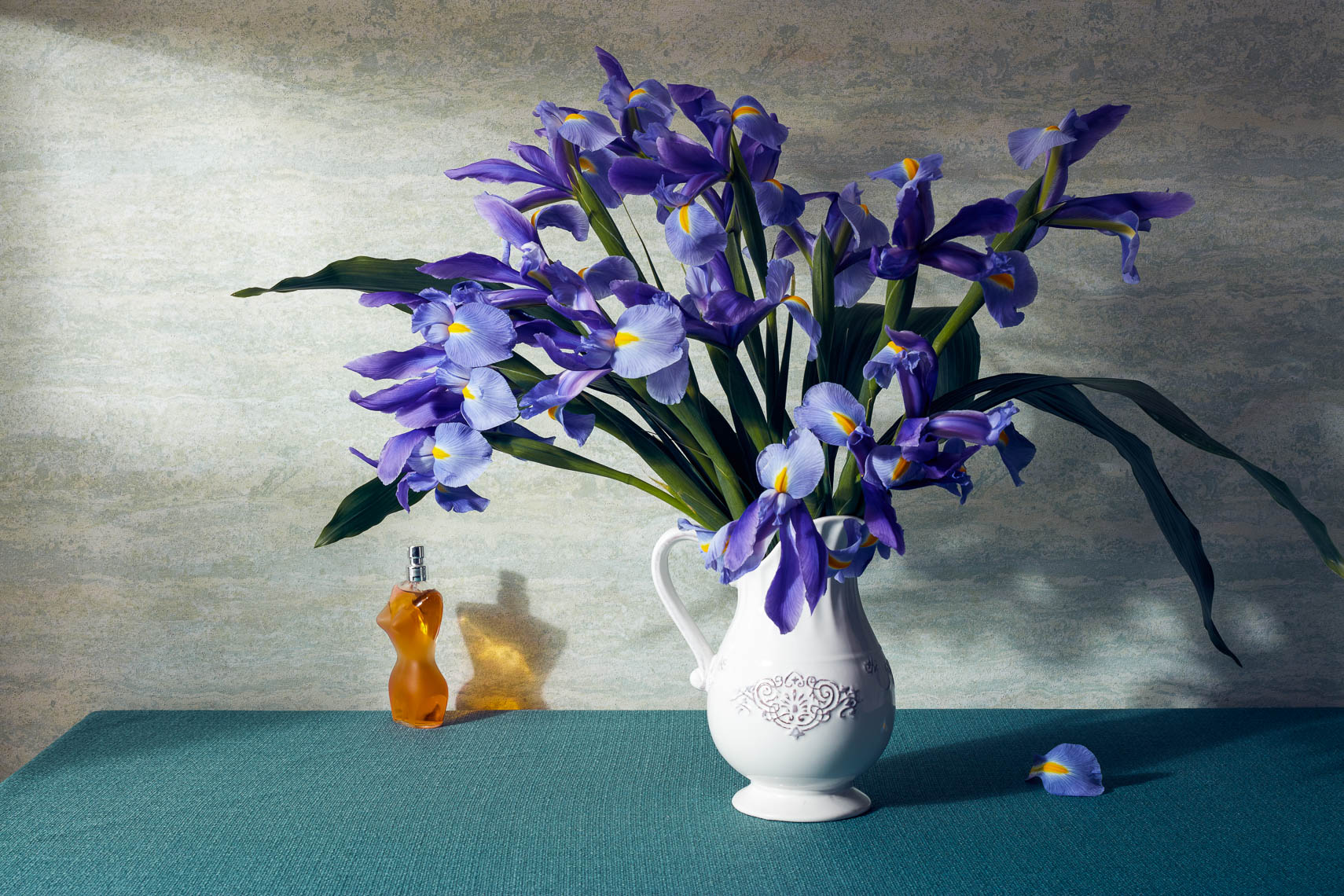 product photographer iris flowers and perfume still life photography with vase