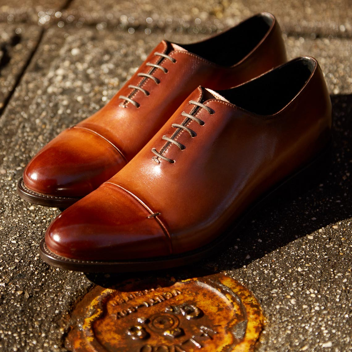 product photographer Mens leather dress shoes on street