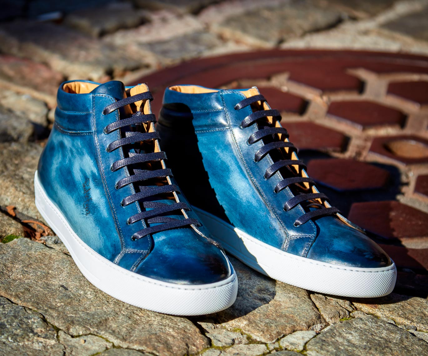 product photographer Mens dark blue leather sneaker