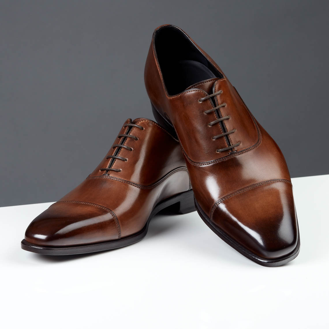 Mens dress shoes on grey background for Paul Evans Shoes in NYC